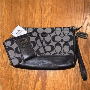 NWT! Coach black wristlet and change purse set.